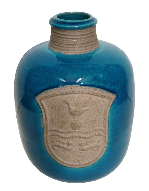 Shiny Blue Ceramic Vase With A Crest Lost And Found